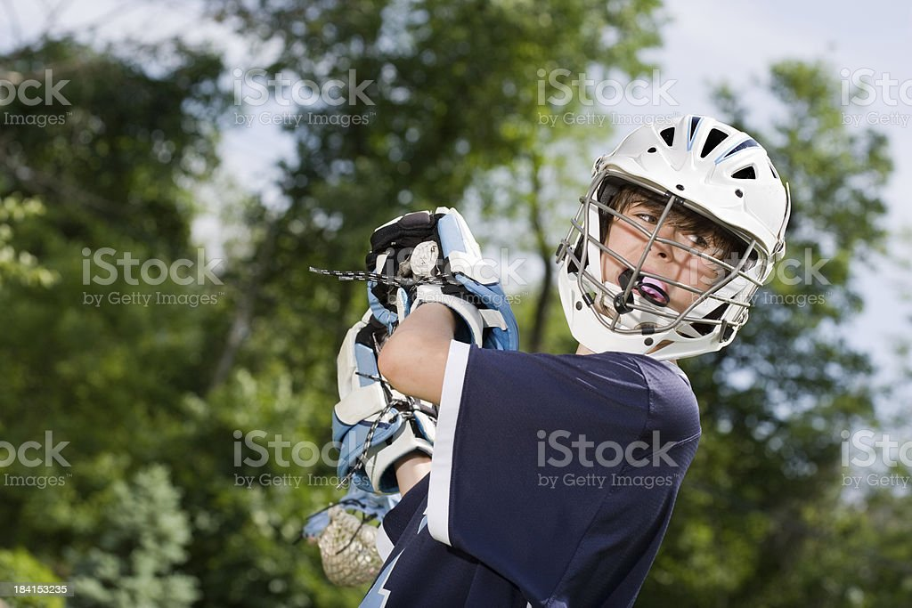 Boy Playing Lacrosse stock photo