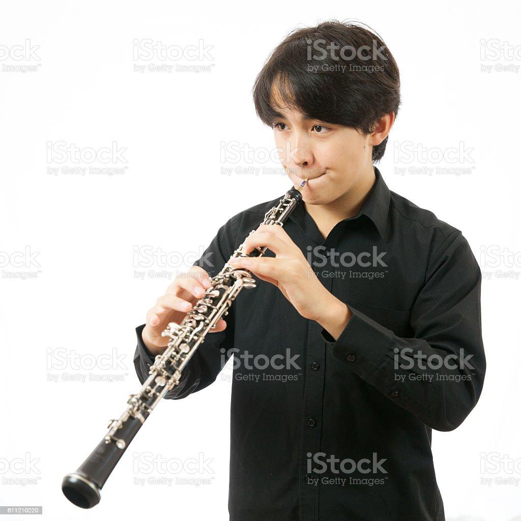 Boy Playing Oboe stock photo
