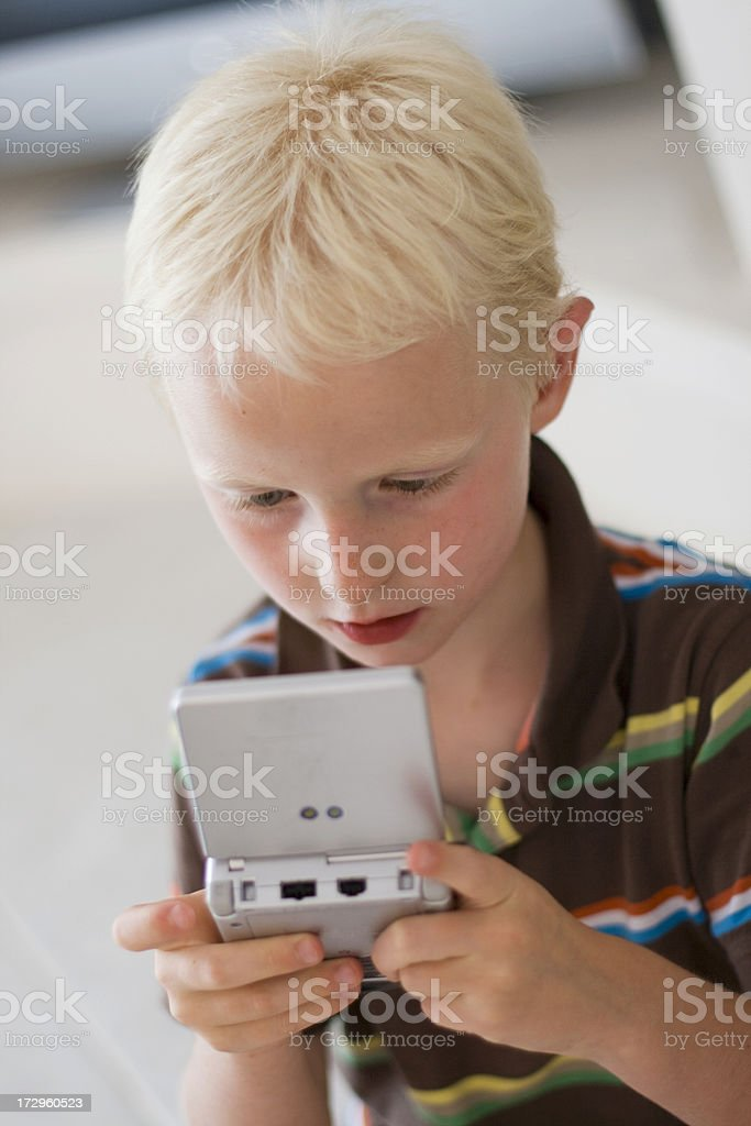 Boy playing on a game console royalty-free stock photo