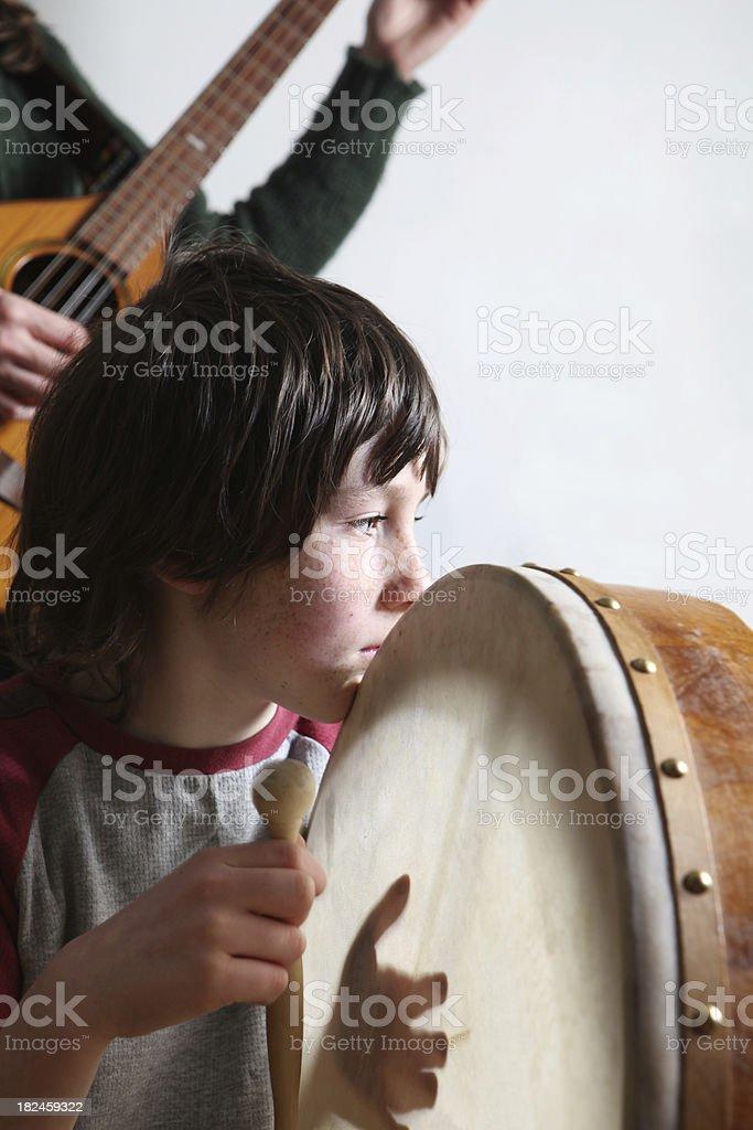 boy playing on bodhran stock photo