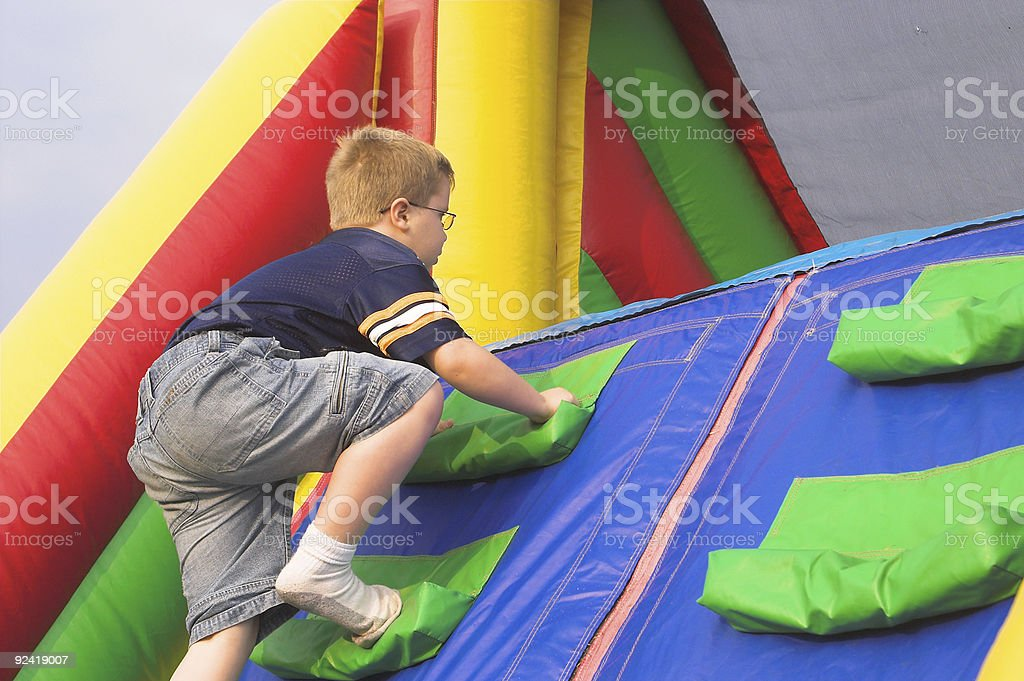 Boy Playing On Obstacle Course stock photo