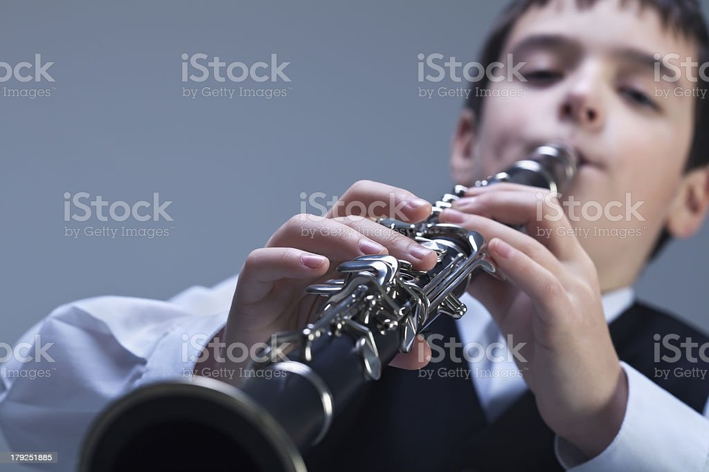 Boy playing on the clarinet stock photo