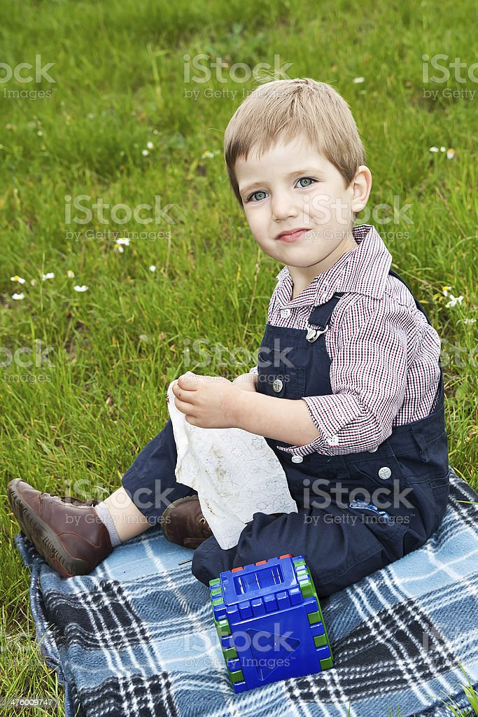 Boy playing on the lawn royalty-free stock photo