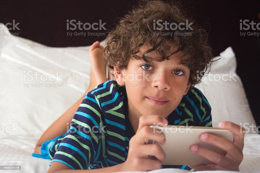 Boy Playing on the Phone stock photo