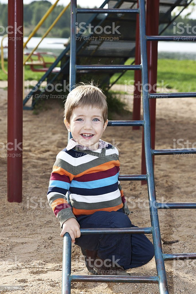 Boy playing on the playground stock photo