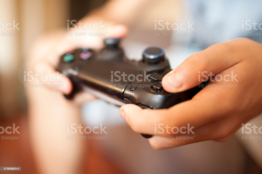 Boy playing on video computer game controller stock photo