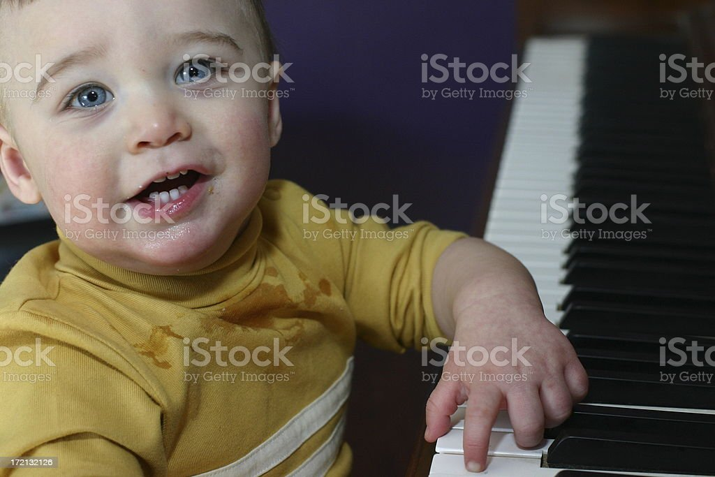 boy playing piano2 stock photo