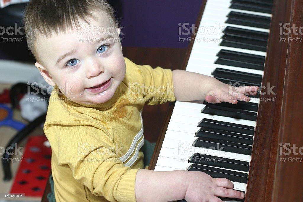 boy playing piano3 stock photo