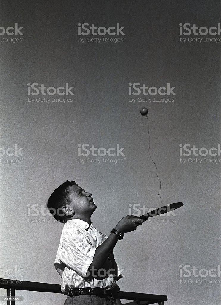 Boy (8-9) playing ping-pong stock photo