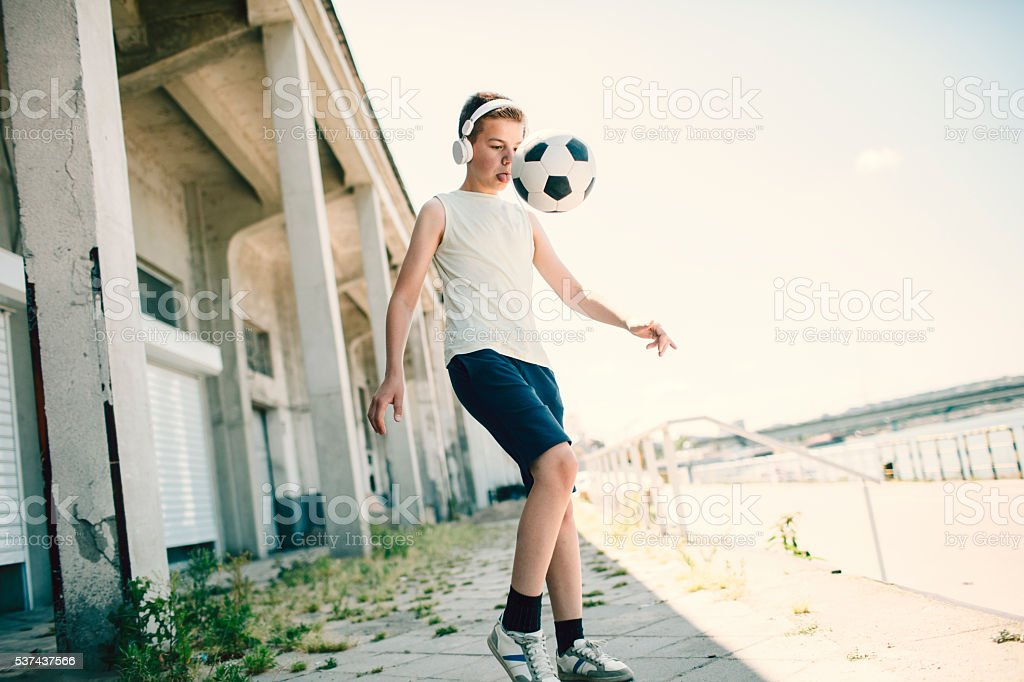 Boy Playing Soccer stock photo