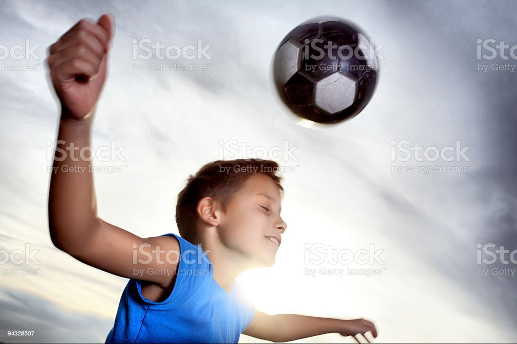 Boy playing soccer. royalty-free stock photo