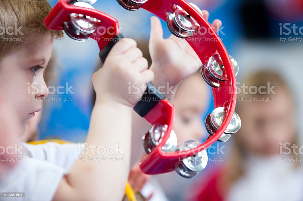 Boy Playing Tambourine at Nursery stock photo