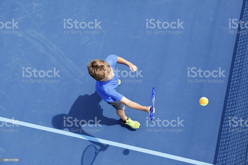 Boy Playing Tennis from Above stock photo