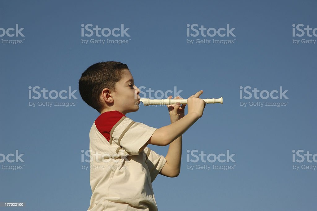 Boy playing the flute stock photo