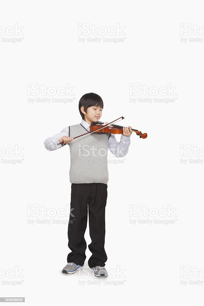 Boy playing the violin stock photo