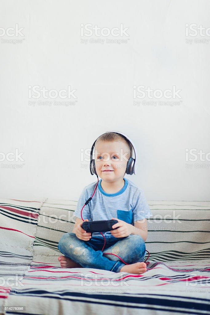 Boy playing video games stock photo