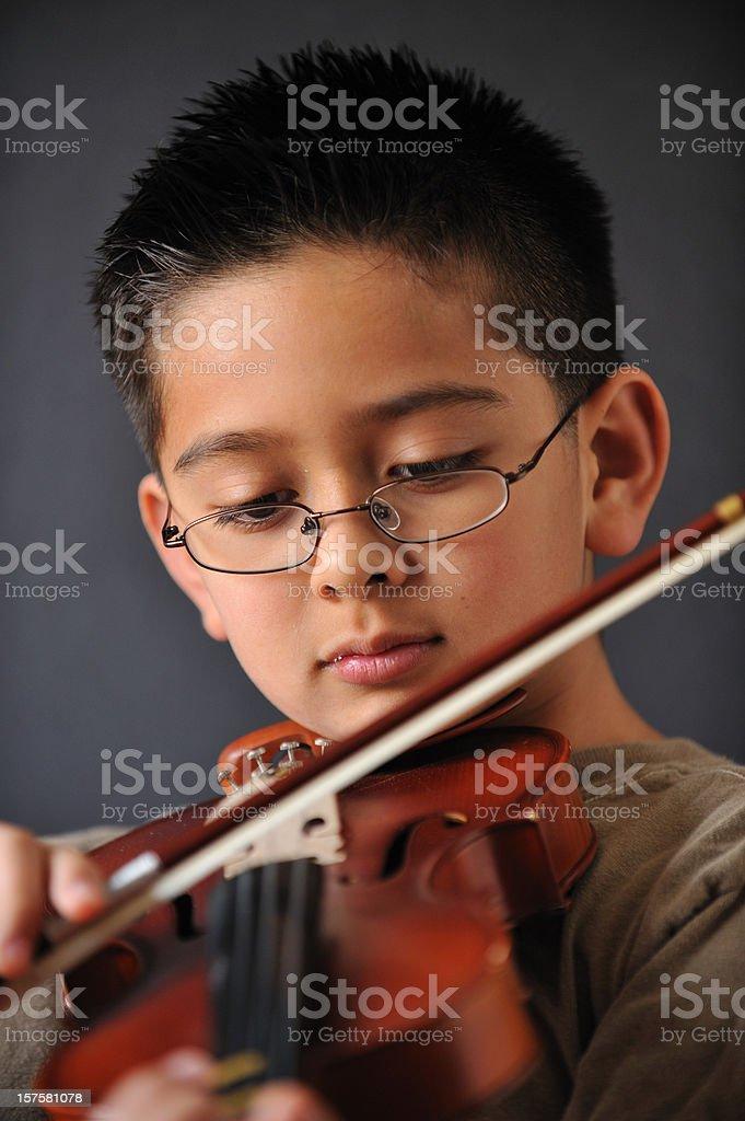 Boy playing violin royalty-free stock photo