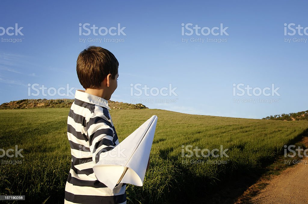 Boy playing with airplane royalty-free stock photo