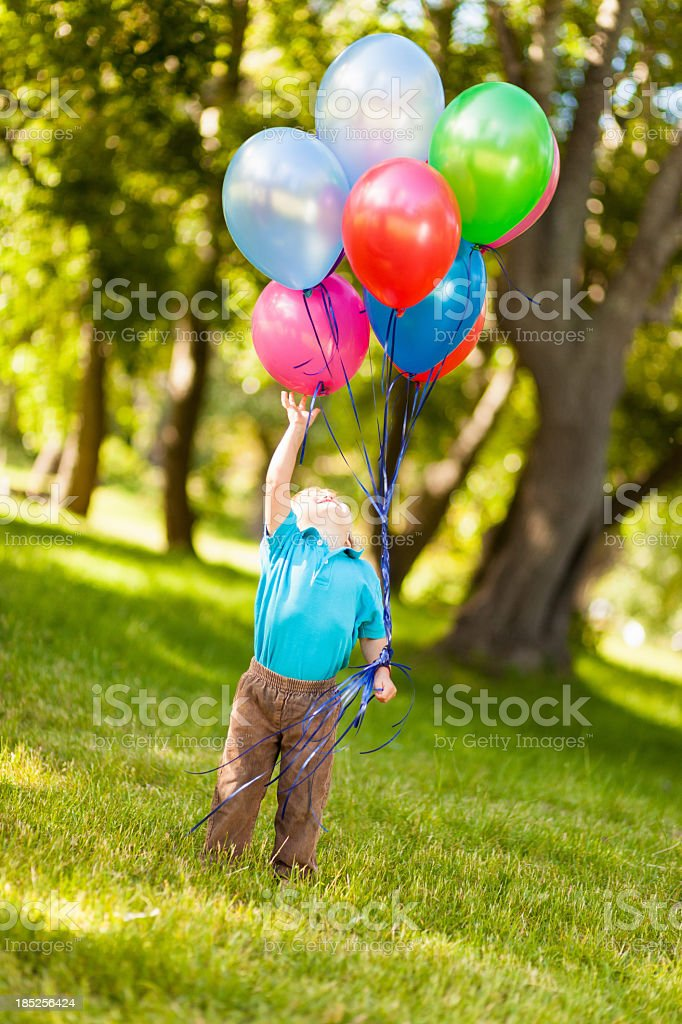 Boy Playing With Balloons. royalty-free stock photo
