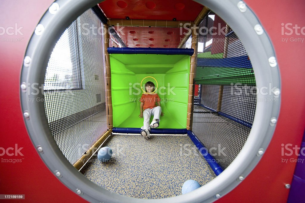 Boy playing with balls in indoors playground royalty-free stock photo