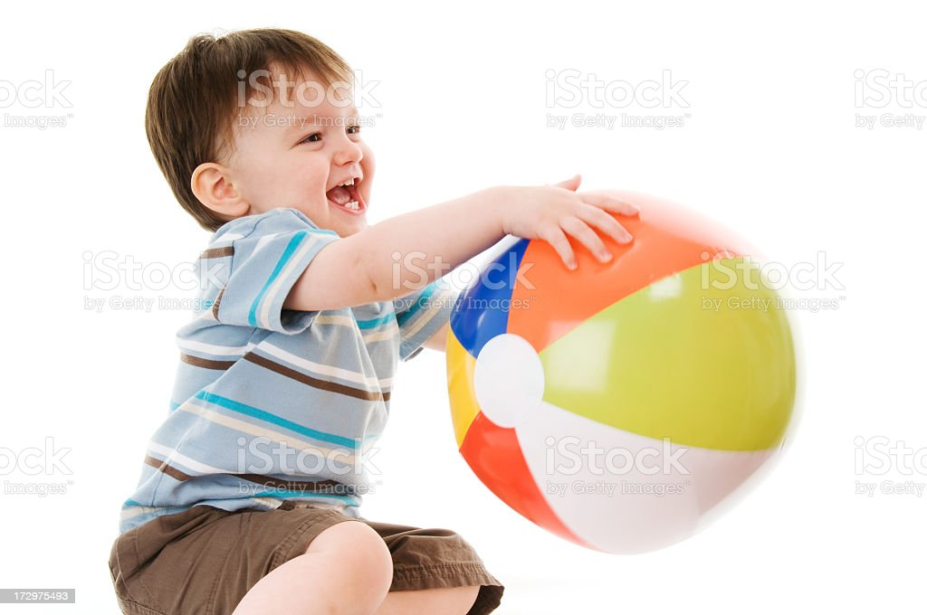Boy playing with beach ball royalty-free stock photo