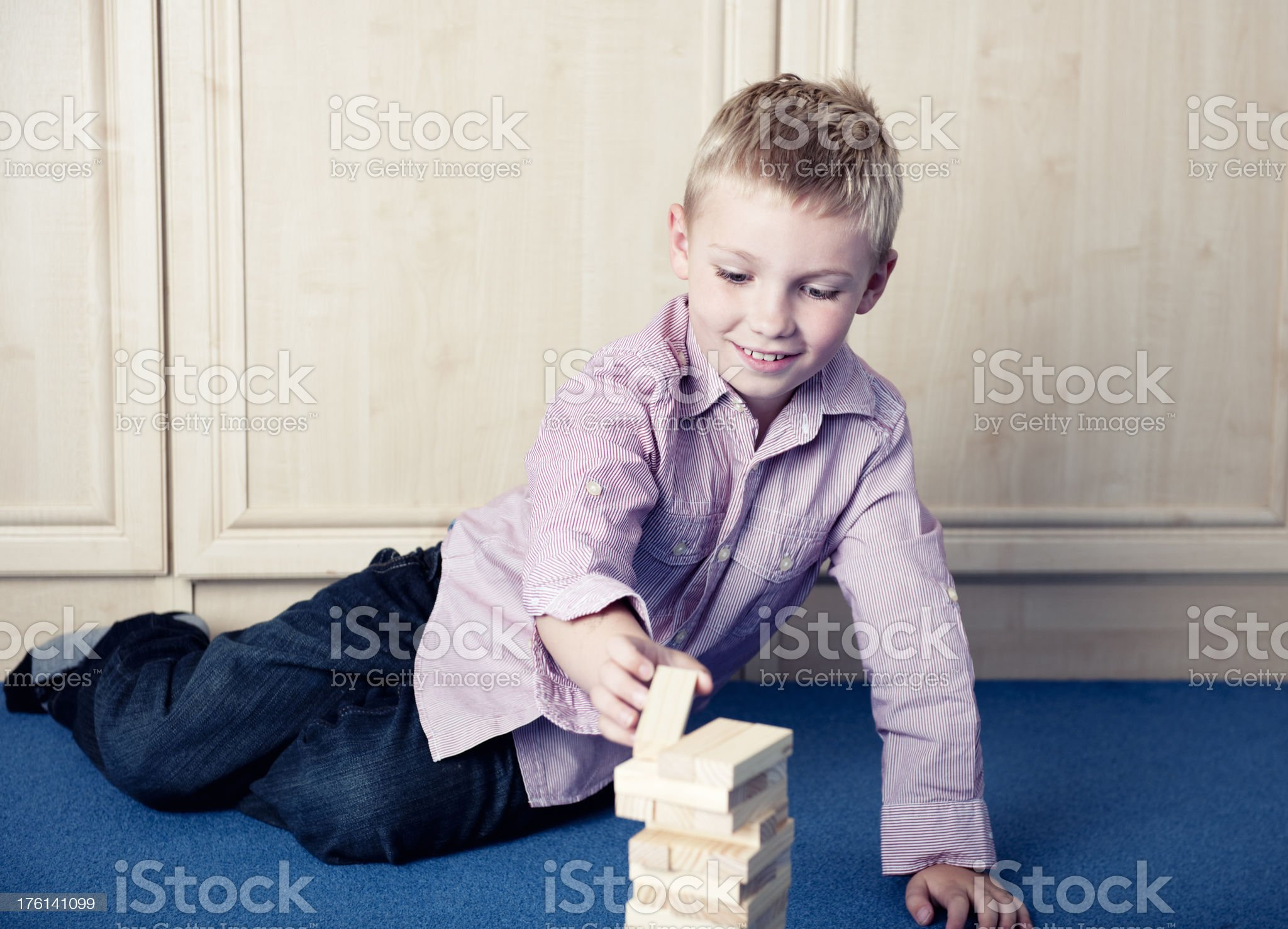 boy playing with blocks in his bedroom royalty-free stock photo