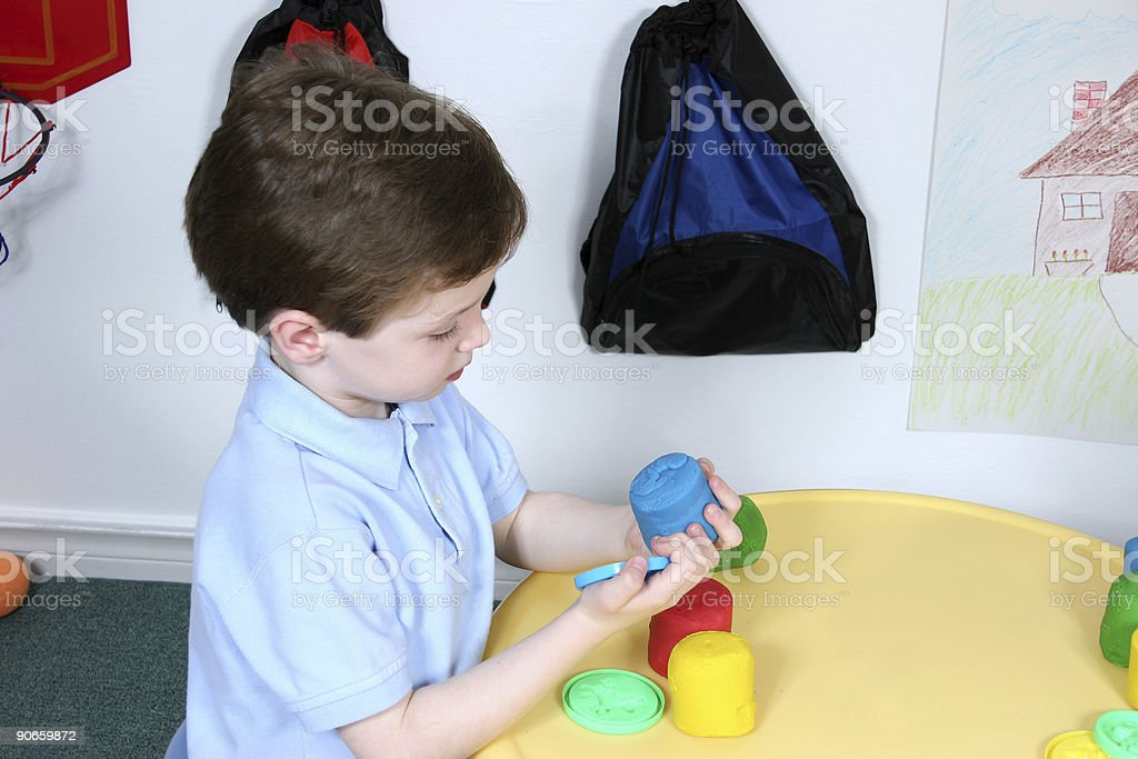 Boy Playing with Colorful Doah at Preschool royalty-free stock photo