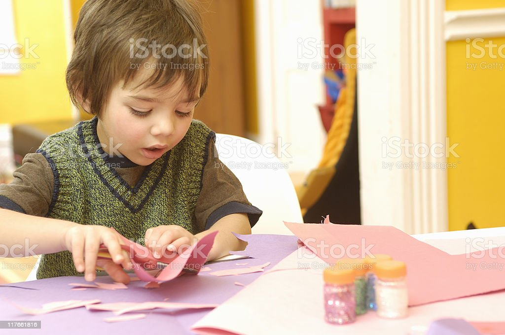 Boy playing with crafts royalty-free stock photo