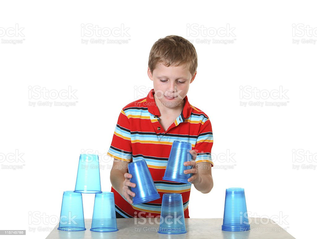 boy playing with cups royalty-free stock photo