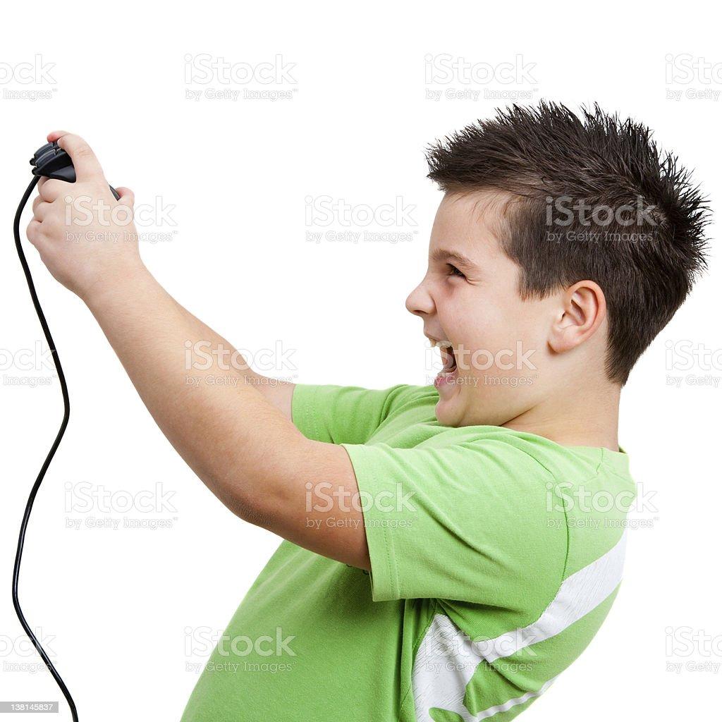 Petit garçon jouant avec une console de jeu photo libre de droits