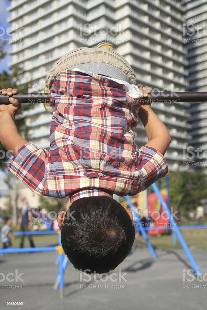Boy playing with iron bar stock photo