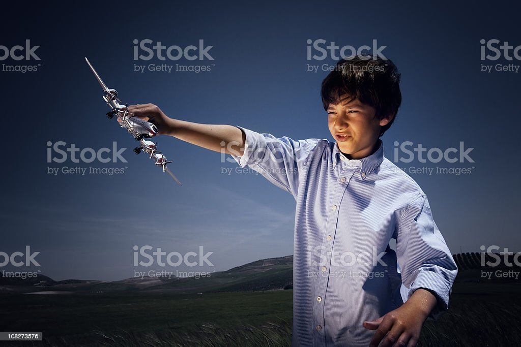 Boy playing with model airplane royalty-free stock photo