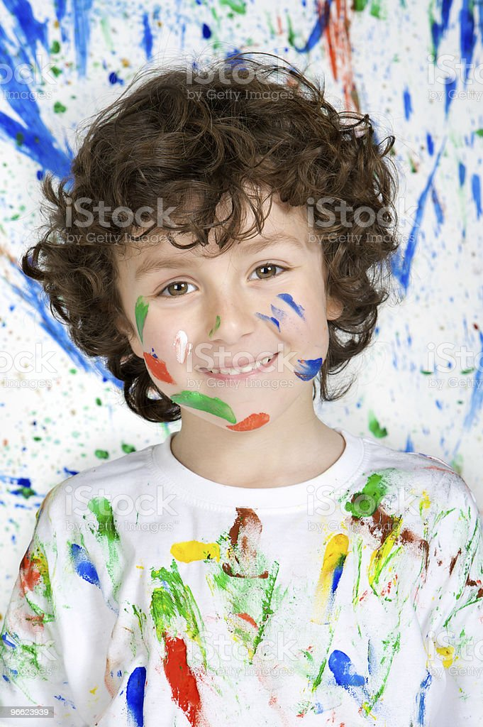 Boy playing with painting stock photo