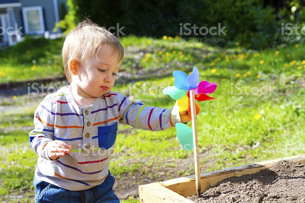 Boy Playing With Wind Toy royalty-free stock photo