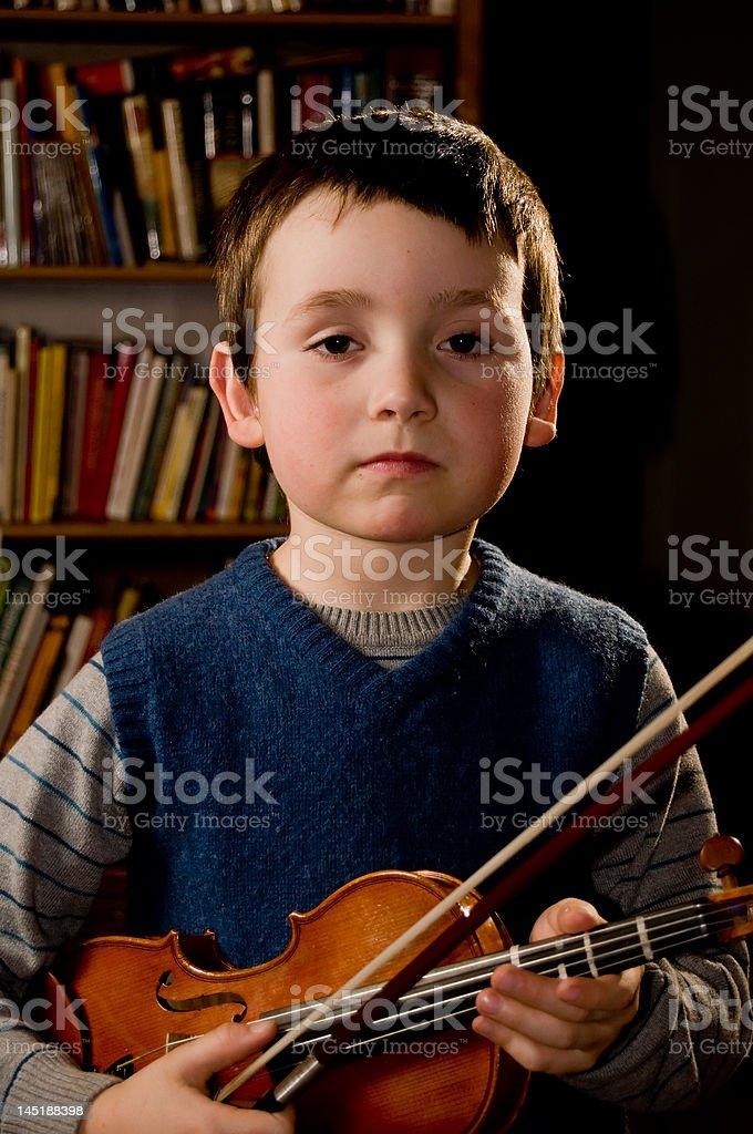 boy playng violn stock photo