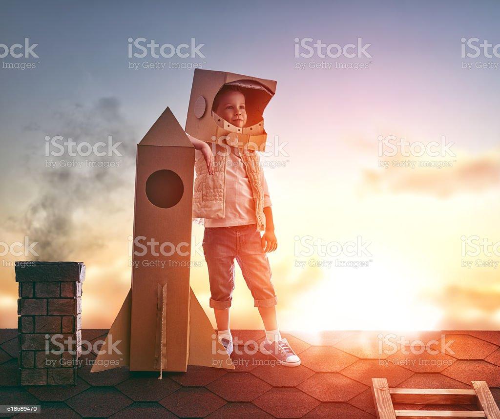 boy plays astronaut stock photo