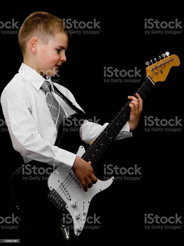 Petit garçon joue Guitare électrique photo libre de droits