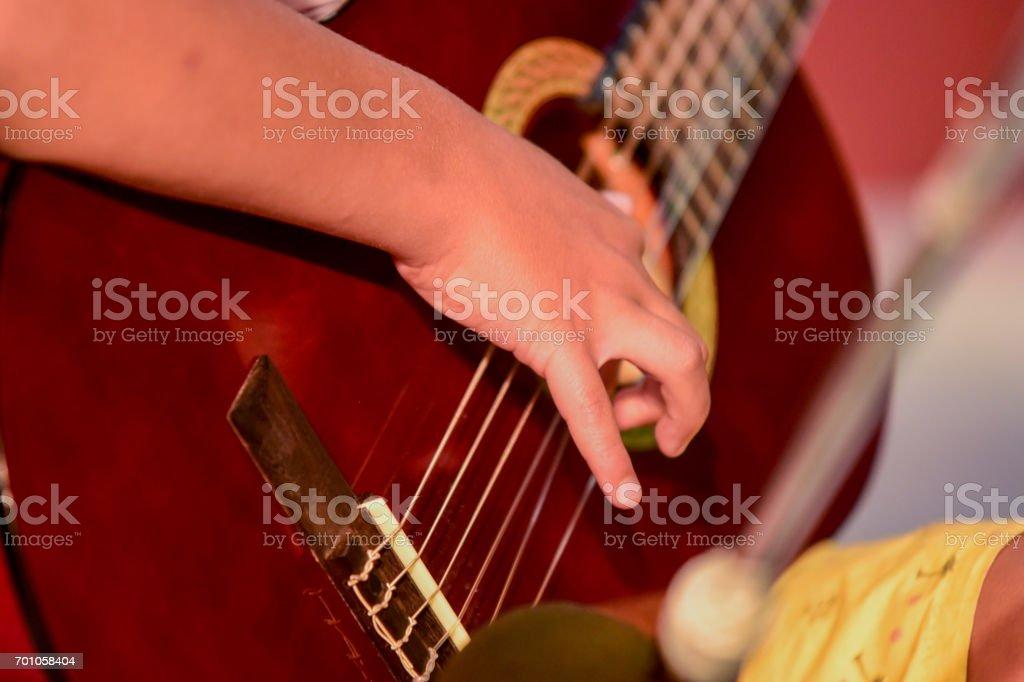 boy plays guitar stock photo