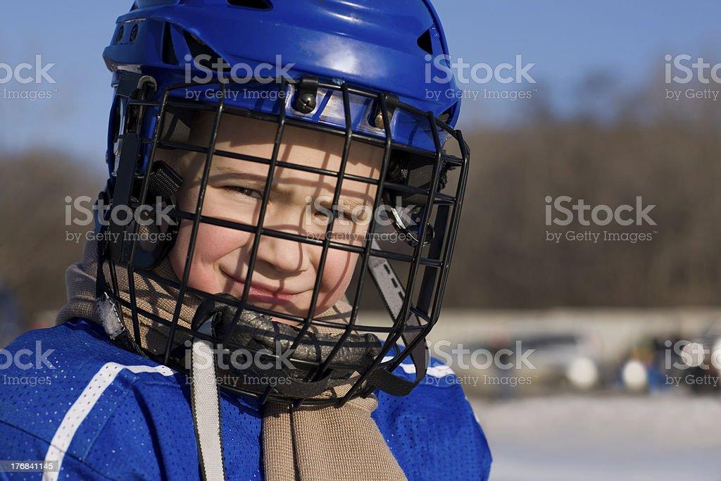 Boy plays hockey royalty-free stock photo