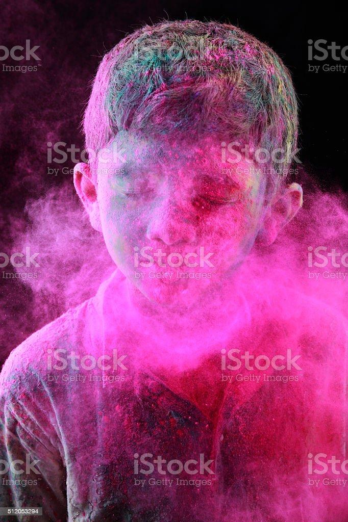 Boy plays Holi stock photo