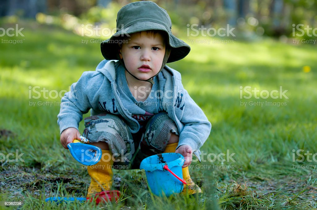 Boy Plays in Mud royalty-free stock photo