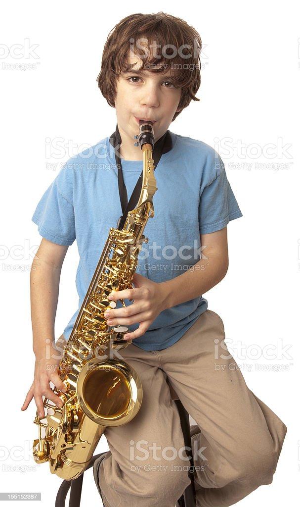 Boy plays Saxophone stock photo