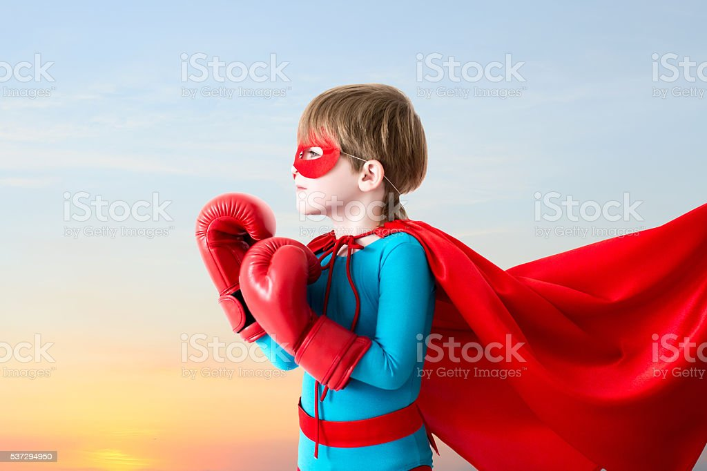 Boy plays super hero. stock photo
