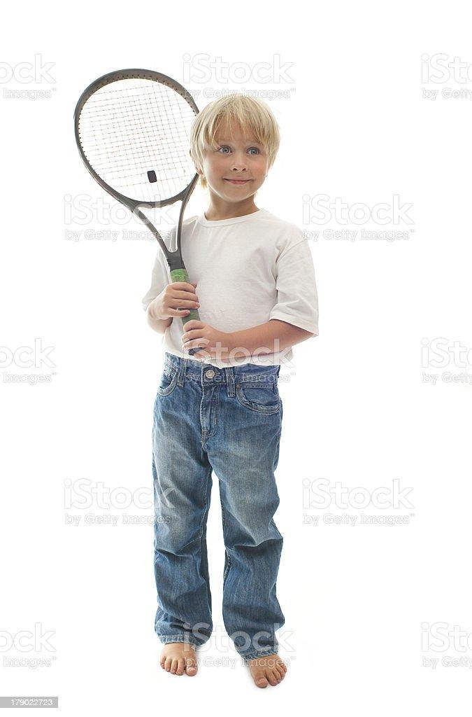 Boy plays tennis royalty-free stock photo