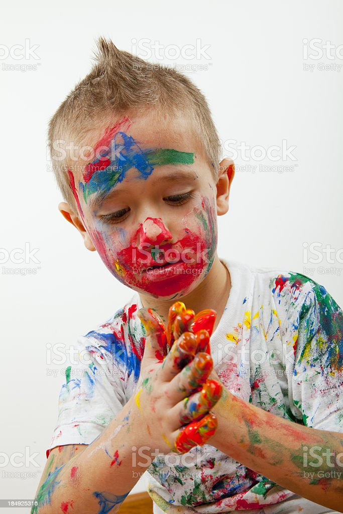 boy plays with paint royalty-free stock photo