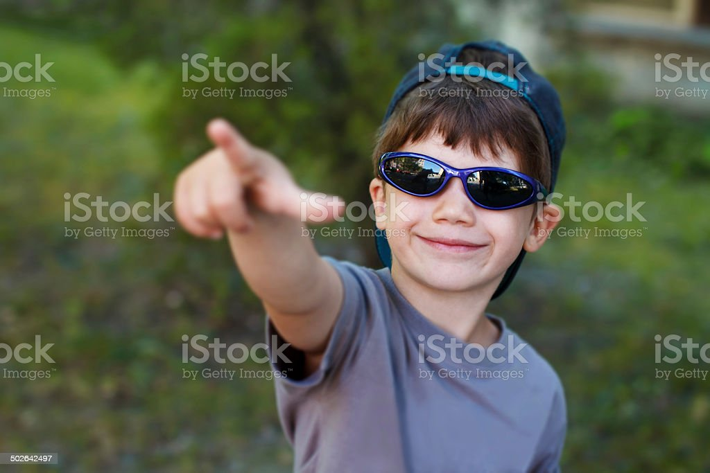 Boy pointing the sky royalty-free stock photo