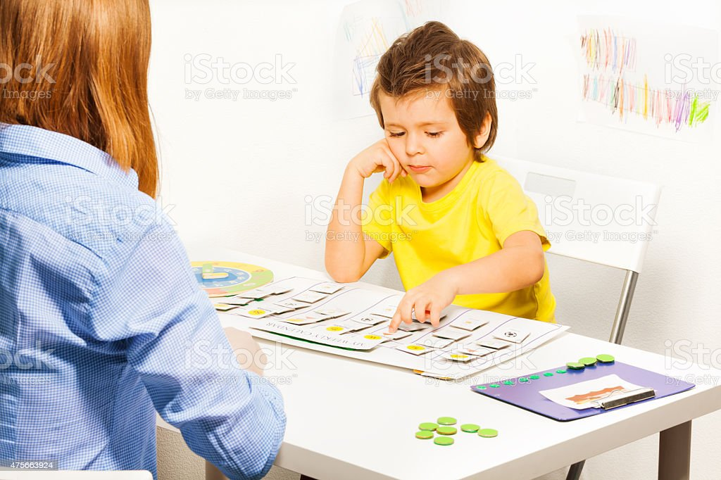 Boy points day activities cards stock photo