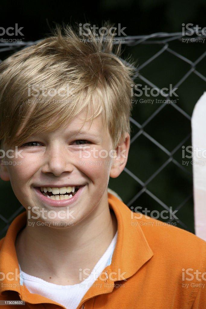 Boy portrait with a laugh stock photo