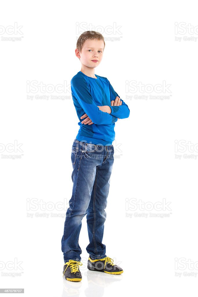Boy posing with arms crossed. stock photo