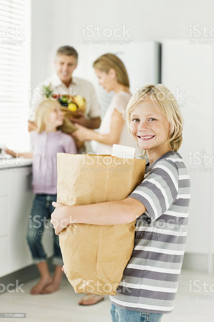 Boy Posing With Groceries royalty-free stock photo